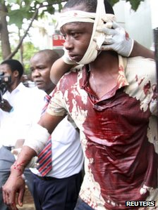 "A man injured during an explosion is assisted from the scene in Kenya""s capital Nairobi, May 28, 2012."