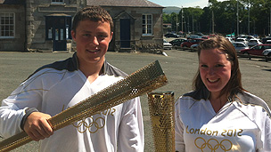 Twins Leon and Sacha Jones, who will carry the torch in Caernarfon