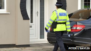 Police Community Support Officer visits a home