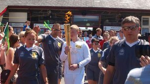 Torch leaving the station at Ffestiniog