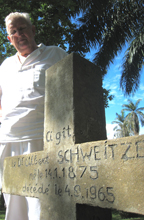 Swiss surgeon, Hans-Peter Muller, stands beside Albert Schweitzer's grave