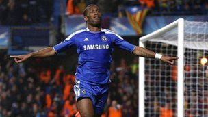 Didier Drogba celebrates a goal during a Champions League match