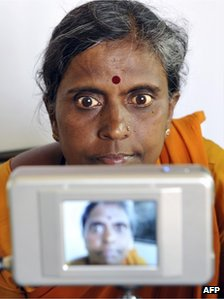 A woman being photographed at an identity centre in India