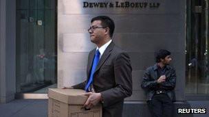 Man walking out of Dewey Leboeuf offices on 11 May