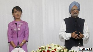 India's Prime Minister Manmohan Singh, right, talks to reporters during a news conference after a meeting with Burma's pro-democracy leader Aung San Suu Kyi in Sedona Hotel in Rangoon on 29 May, 2012