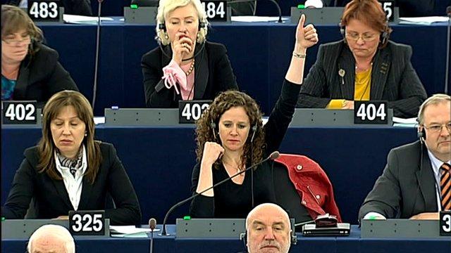 Woman raising her thumb
