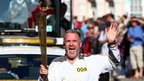 Radio 1 presenter Chris Moyles carries the torch in Aberystwyth
