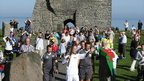 Colin Davies holds the Olympic flame on the Torch Relay leg from Aberystwyth 