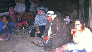 Group of Palestinians sitting inside a cave