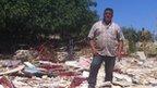 zi Kasiyah standing in the rubble