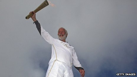 Sir Chris Bonington with the torch on Snowdon
