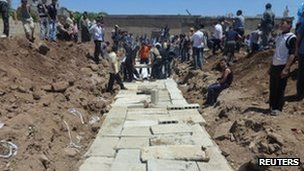 Concrete slabs are seen over a mass burial site for those killed in Friday&#039;s attacks in Houla