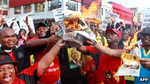 Protesters burn copies of the City Press newspaper that first published a photograph of a controversial painting by Brett Murray on 26 May 2012