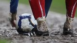 A muddy football pitch