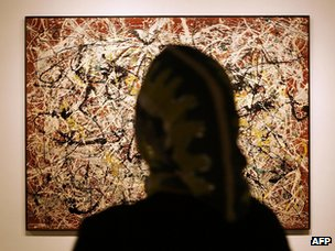 Woman views Jackson Pollock's Mural on Indian Red Ground