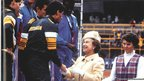 The Queen presents medals to the Australian 4 x 400 metres relay team at the 1986 Commonwealth Games in Edinburgh