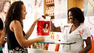 A customer being handed her products