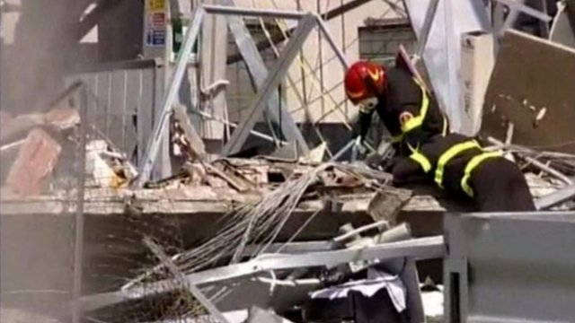 Emergency services dig through rubble