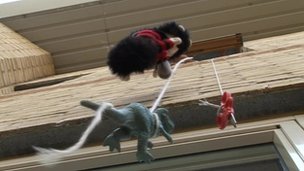Toys dangling from window