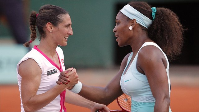 Virginie Razzano shakes hands with Serena Williams