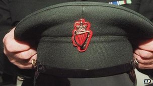 RUC officer holds his cap