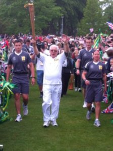 Ronald Price carrying the flame in Wrexham