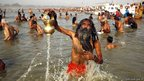 Hindu devotees take holy dip at the Sangam, the confluence of the Rivers Ganges, Yamuna and the mythical Saraswati