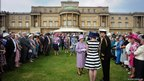 Queen Elizabeth II meets guests during a garden party at Buckingham Palace, London