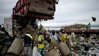"Rubbish collectors known as ""catadores"" pick through Rio's biggest dump"