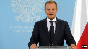 "Poland's Prime Minister Donald Tusk addresses reporters in Warsaw after President Barack Obama called Nazi death camps set up in occupied Poland during World War II ""Polish""."