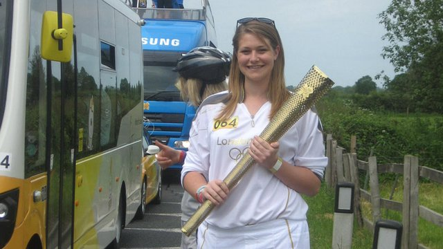 Torchbearer Becky with the Olympic torch