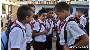 School children chat in the playground at a school in Havana