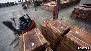 Copper cathodes stacked in a warehouse near Shanghai
