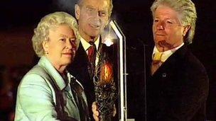 The Queen is overseen by Bruno Peek as she lights a beacon