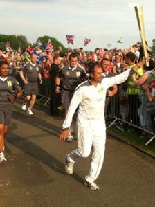 Imran Sherwani carrying the torch in Stoke
