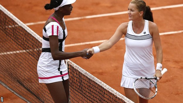 Venus Williams (left) congratulates Agnieszka Radwanska on her victory