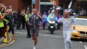 Stoke City FC manager Tony Pulis with the torch