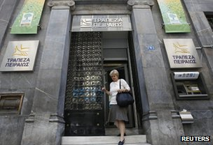 Woman leaving a Greek bank