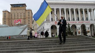 Fan with a Ukrainian flag in Independence Square, Kiev