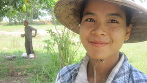 Woman subsistence farmer in hat