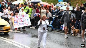 Carol Highton carries the Olympic flame on the torch relay leg between Runcorn and Widnes, 31 May 2012