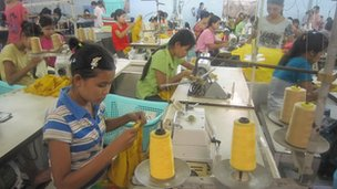 women at sewing machines in garment factory