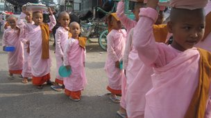 Young Burmese nuns crossing a road