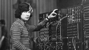 Bernie Krause stands at a moog synthesiser