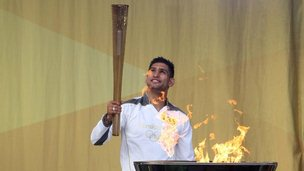 Amir Khan lighting the cauldron in Bolton's Queen's Park