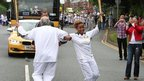 Torchbearers Cyril Baker and Jazmin Sawyers dance a jig in Congleton