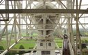 Torchbearer John Bishop takes the flame up Jodrell Bank's Lovell Telescope