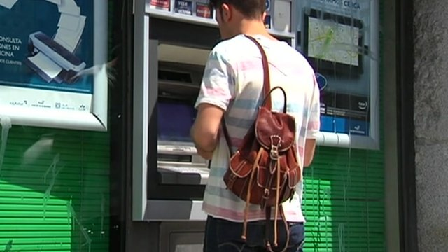 Person at a cash machine in Spain