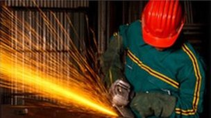 worker using angle grinder cutter