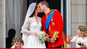 Prince William and his wife Kate Middleton, who has been given the title of The Duchess of Cambridge, kiss on the balcony of Buckingham Palace, London after their wedding